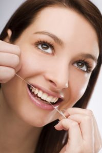 Woman flossing happy.