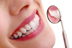 healthy smile and dental mirror